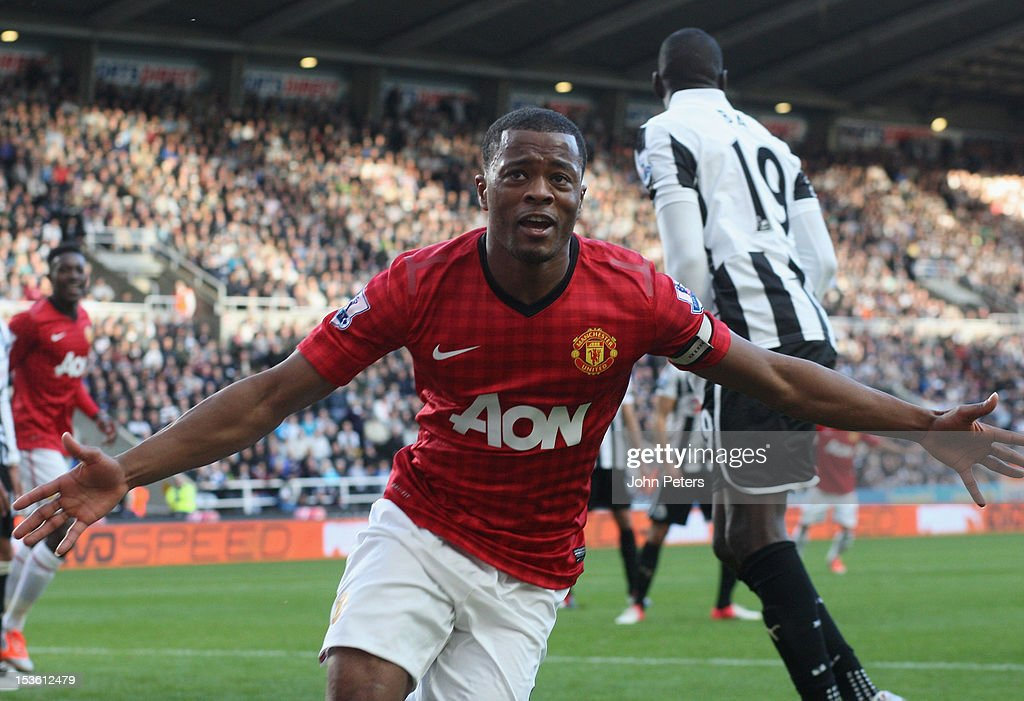 Patrice Evra of Manchester United celebrates scoring their first goal during the Barclays Premier League match between Newcastle United and Manchester United at Sports Direct Arena on October 7, 2012 in Newcastle upon Tyne, England.