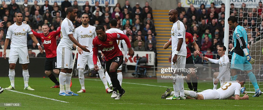 <a gi-track='captionPersonalityLinkClicked' href=/galleries/search?phrase=Patrice+Evra&family=editorial&specificpeople=714865 ng-click='$event.stopPropagation()'>Patrice Evra</a> of Manchester United celebrates scoring their first goal during the Barclays Premier League match between Swansea City and Manchester United at Liberty Stadium on December 23, 2012 in Swansea, Wales.