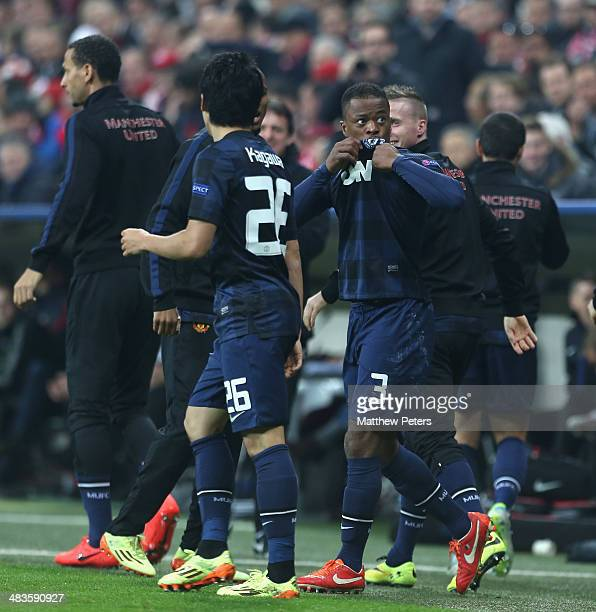 Patrice Evra of Manchester United celebrates scoring their first goal during the UEFA Champions League quarterfinal second leg match between Bayern...