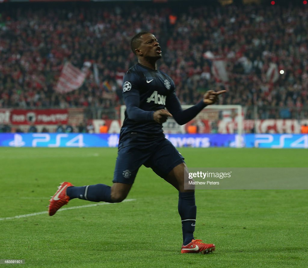 <a gi-track='captionPersonalityLinkClicked' href=/galleries/search?phrase=Patrice+Evra&family=editorial&specificpeople=714865 ng-click='$event.stopPropagation()'>Patrice Evra</a> of Manchester United celebrates scoring their first goal during the UEFA Champions League quarter-final second leg match between Bayern Munich and Manchester United at Allianz Arena on April 9, 2014 in Munich, Germany.