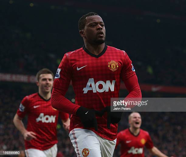 Patrice Evra of Manchester United celebrates scoring their second goal during the Barclays Premier League match between Manchester United and...