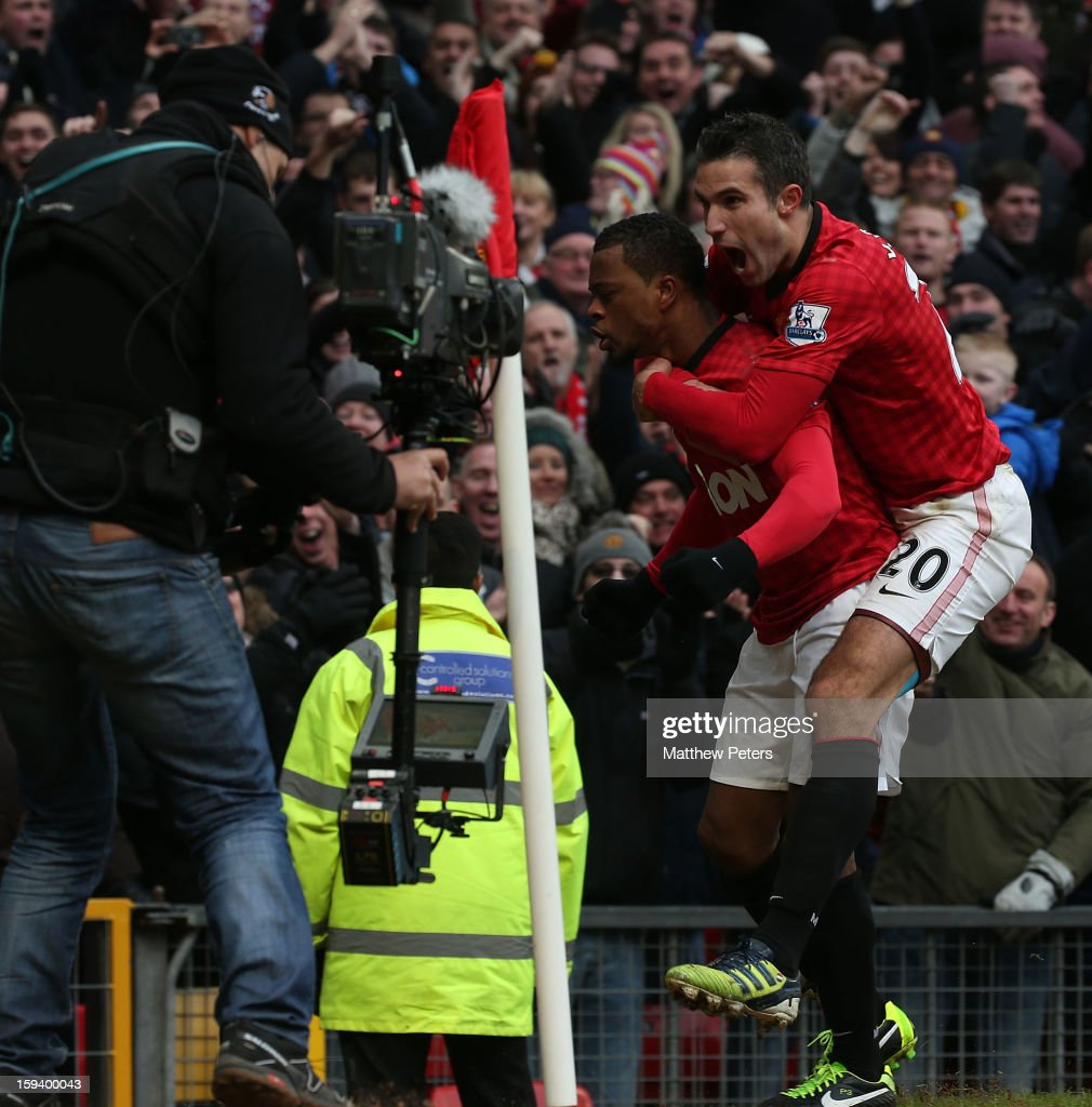 <a gi-track='captionPersonalityLinkClicked' href=/galleries/search?phrase=Patrice+Evra&family=editorial&specificpeople=714865 ng-click='$event.stopPropagation()'>Patrice Evra</a> of Manchester United celebrates scoring their second goal during the Barclays Premier League match between Manchester United and Liverpool at Old Trafford on January 13, 2013 in Manchester, England.
