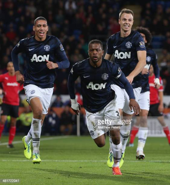 Patrice Evra of Manchester United celebrates scoring their second goal during the Barclays Premier League match between Cardiff City and Manchester...