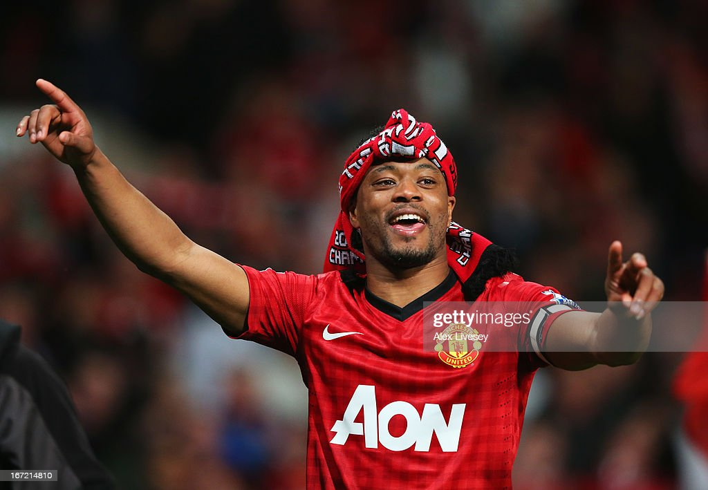 <a gi-track='captionPersonalityLinkClicked' href=/galleries/search?phrase=Patrice+Evra&family=editorial&specificpeople=714865 ng-click='$event.stopPropagation()'>Patrice Evra</a> of Manchester United celebrates victory and winning the Premier League title after the Barclays Premier League match between Manchester United and Aston Villa at Old Trafford on April 22, 2013 in Manchester, England.