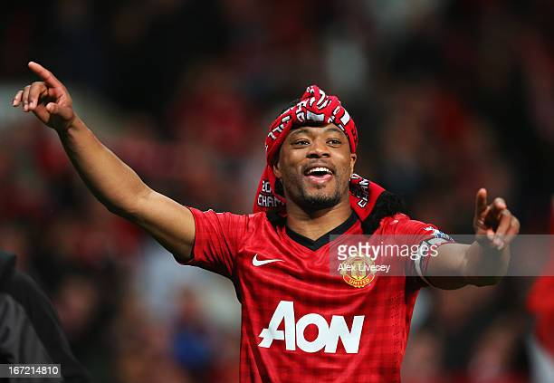 Patrice Evra of Manchester United celebrates victory and winning the Premier League title after the Barclays Premier League match between Manchester...