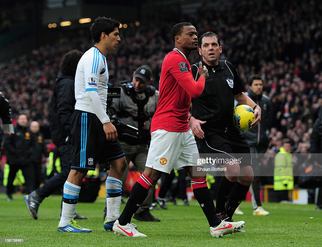 <a gi-track='captionPersonalityLinkClicked' href=/galleries/search?phrase=Patrice+Evra&family=editorial&specificpeople=714865 ng-click='$event.stopPropagation()'>Patrice Evra</a> of Manchester United celebrates victory as he walks off with Luis Suarez of Liverpool during the Barclays Premier League match between Manchester United and Liverpool at Old Trafford on February 11, 2012 in Manchester, England.