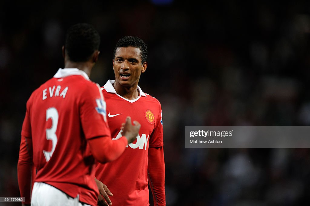 Patrice Evra of Manchester United chats to Nani of Manchester United