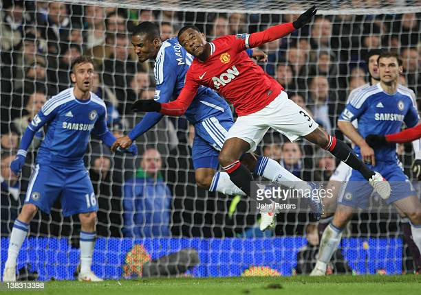 Patrice Evra of Manchester United clashes with Florent Malouda of Chelsea during the Barclays Premier League match between Chelsea and Manchester...