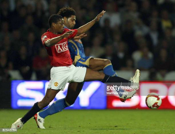 Patrice Evra of Manchester United clashes with Glen Johnson of Portsmouth during the FA Premier League match between Portsmouth and Manchester United...