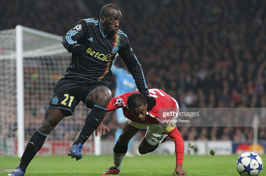 <a gi-track='captionPersonalityLinkClicked' href=/galleries/search?phrase=Patrice+Evra&family=editorial&specificpeople=714865 ng-click='$event.stopPropagation()'>Patrice Evra</a> of Manchester United clashes with <a gi-track='captionPersonalityLinkClicked' href=/galleries/search?phrase=Souleymane+Diawara&family=editorial&specificpeople=695613 ng-click='$event.stopPropagation()'>Souleymane Diawara</a> of Olympique Marseille during the UEFA Champions League Round of 16 match between Manchester United and Olympique Marseille at Old Trafford on March 15, 2011 in Manchester, England.