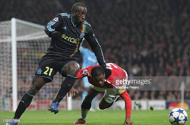 Patrice Evra of Manchester United clashes with Souleymane Diawara of Olympique Marseille during the UEFA Champions League Round of 16 match between...