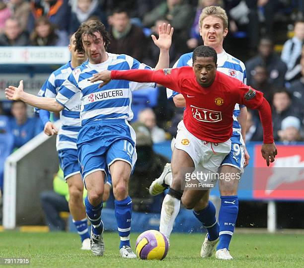 Patrice Evra of Manchester United clashes with Steven Hunt and Kevin Doyle of Reading during the Barclays FA Premier League match between Reading and...