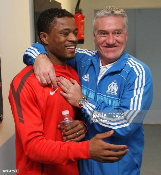 Patrice Evra of Manchester United greets Didier Deschamps of Olympique Marseille ahead of a first team training session ahead of their UEFA Champions...