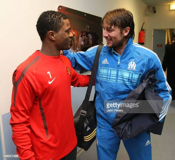 Patrice Evra of Manchester United greets Gabriel Heinze of Olympique Marseille ahead of a first team training session ahead of their UEFA Champions...