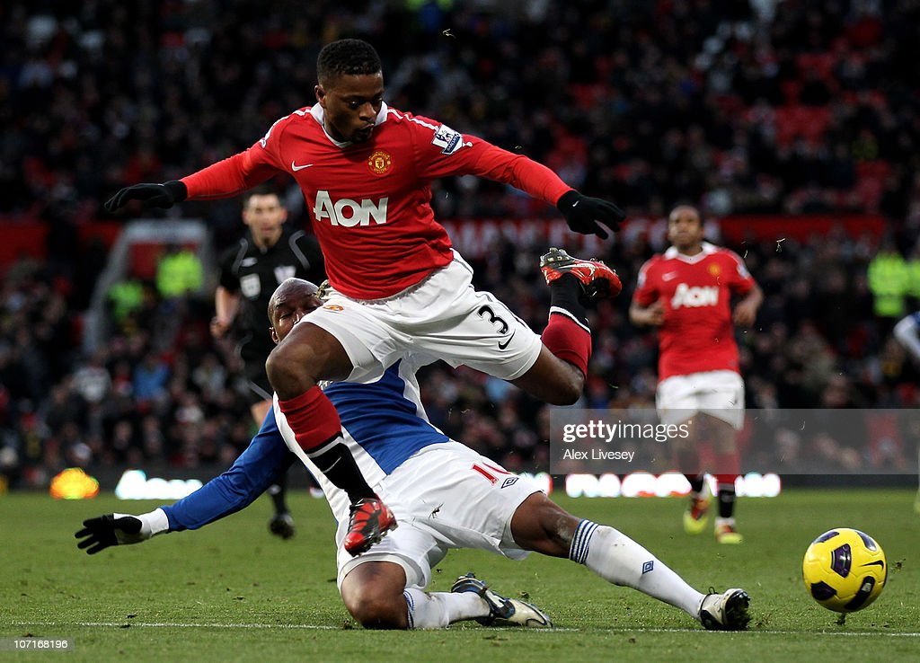 <a gi-track='captionPersonalityLinkClicked' href=/galleries/search?phrase=Patrice+Evra&family=editorial&specificpeople=714865 ng-click='$event.stopPropagation()'>Patrice Evra</a> of Manchester United hurdles the challenge of El Hadji Diouf of Blackburn Rovers during the Barclays Premier League match between Manchester United and Blackburn Rovers at Old Trafford on November 27, 2010 in Manchester, England.