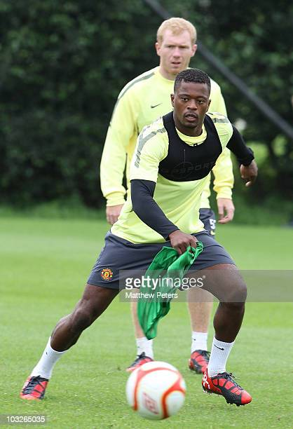 Patrice Evra of Manchester United in action during a first team training session at Carrington Training Ground on August 6 2010 in Manchester England