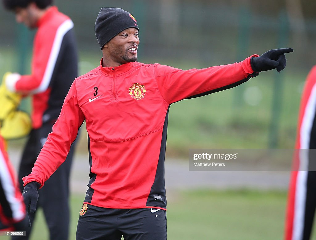 <a gi-track='captionPersonalityLinkClicked' href=/galleries/search?phrase=Patrice+Evra&family=editorial&specificpeople=714865 ng-click='$event.stopPropagation()'>Patrice Evra</a> of Manchester United in action during a first team training session, ahead of their UEFA Champions League Round of 16 match against Olympiacos, at Aon Training Complex on February 24, 2014 in Manchester, England.