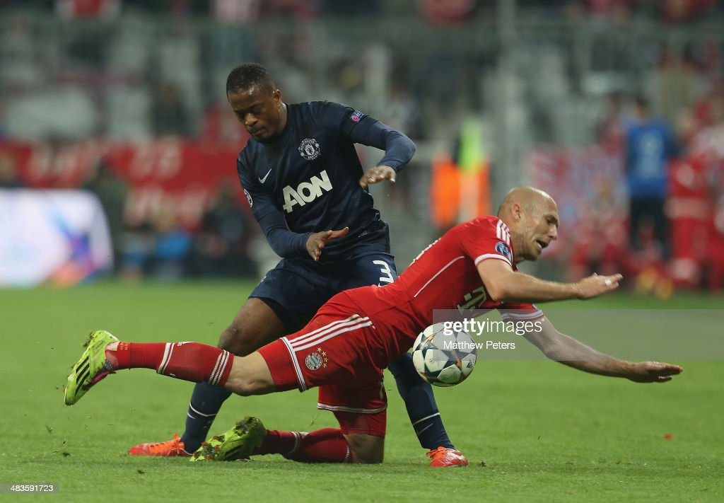 Patrice Evra of Manchester United in action with Arjen Robben of Bayern Munich during the UEFA Champions League quarter-final second leg match between Bayern Munich and Manchester United at Allianz Arena on April 9, 2014 in Munich, Germany.