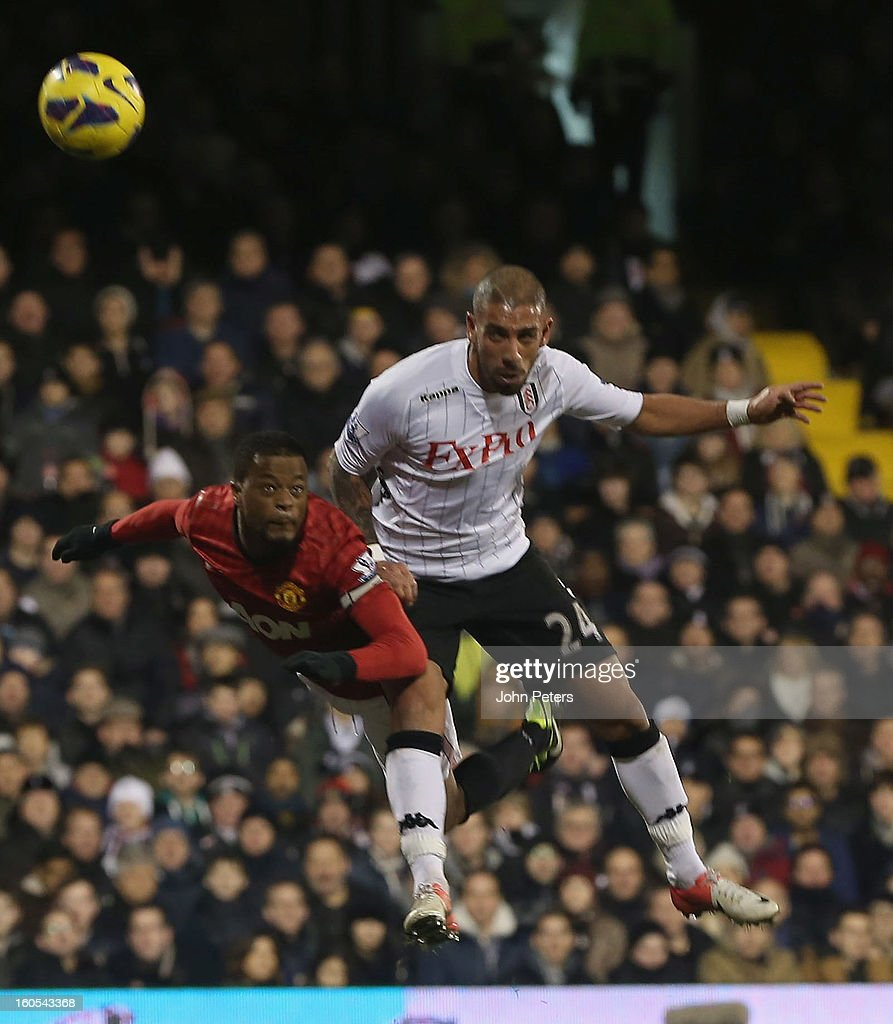 <a gi-track='captionPersonalityLinkClicked' href=/galleries/search?phrase=Patrice+Evra&family=editorial&specificpeople=714865 ng-click='$event.stopPropagation()'>Patrice Evra</a> of Manchester United in action with <a gi-track='captionPersonalityLinkClicked' href=/galleries/search?phrase=Ashkan+Dejagah&family=editorial&specificpeople=4024305 ng-click='$event.stopPropagation()'>Ashkan Dejagah</a> of Fulham during the Barclays Premier League match between Fulham and Manchester United at Craven Cottage on February 2, 2013 in London, England.