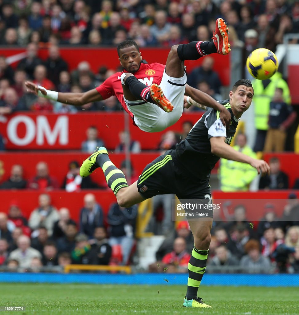 <a gi-track='captionPersonalityLinkClicked' href=/galleries/search?phrase=Patrice+Evra&family=editorial&specificpeople=714865 ng-click='$event.stopPropagation()'>Patrice Evra</a> of Manchester United in action with <a gi-track='captionPersonalityLinkClicked' href=/galleries/search?phrase=Geoff+Cameron&family=editorial&specificpeople=5101639 ng-click='$event.stopPropagation()'>Geoff Cameron</a> of Stoke City during the Barclays Premier League match between Manchester United and Stoke City at Old Trafford on October 26, 2013 in Manchester, England.