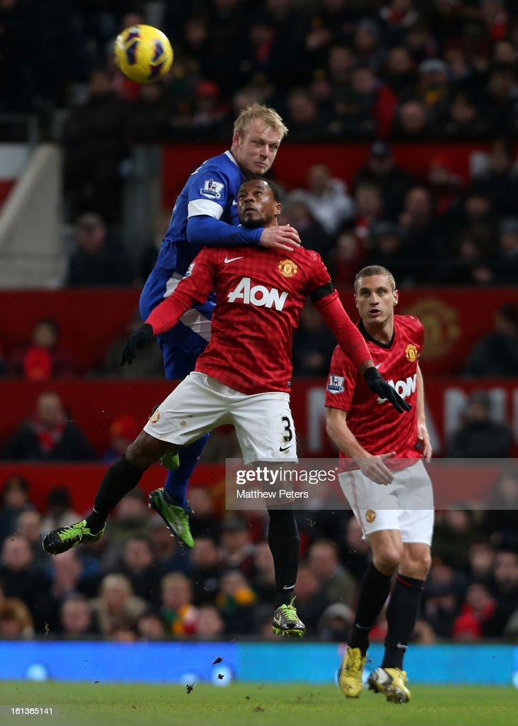 Patrice Evra of Manchester United in action with Steven Naismith of Everton during the Barclays Premier League match between Manchester United and Everton at Old Trafford on February 10, 2013 in Manchester, England.