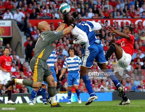 Patrice Evra of Manchester United is denied by Marcus Hahnemann and Kevin Doyle of Reading during the Premier league football match at Old Trafford...