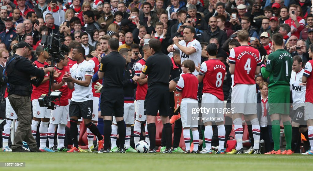<a gi-track='captionPersonalityLinkClicked' href=/galleries/search?phrase=Patrice+Evra&family=editorial&specificpeople=714865 ng-click='$event.stopPropagation()'>Patrice Evra</a> of Manchester United leads the team out through a guard of honour formed by the Arsenam team ahead of the Barclays Premier League match between Arsenal and Manchester United at Emirates Stadium on April 28, 2013 in London, England.