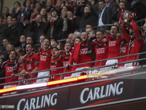 Patrice Evra of Manchester United lifts the Carling Cup trophy after the Carling Cup Final match between Aston Villa and Manchester United at Wembley...