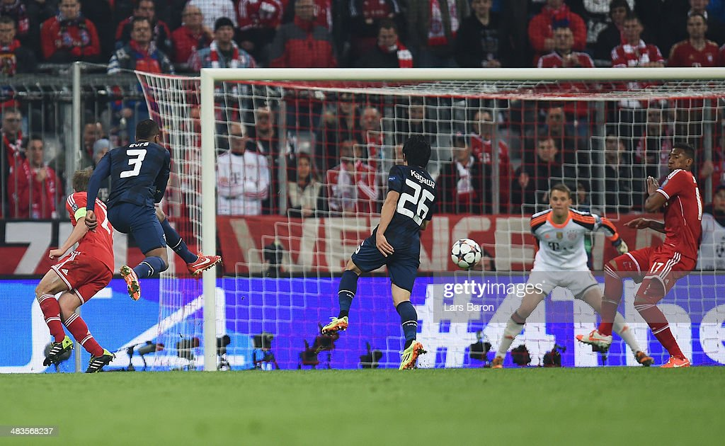 <a gi-track='captionPersonalityLinkClicked' href=/galleries/search?phrase=Patrice+Evra&family=editorial&specificpeople=714865 ng-click='$event.stopPropagation()'>Patrice Evra</a> of Manchester United scores his goal during the UEFA Champions League Quarter Final second leg match between FC Bayern Muenchen and Manchester United at Allianz Arena on April 9, 2014 in Munich, Germany.