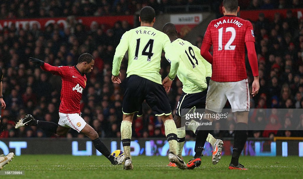<a gi-track='captionPersonalityLinkClicked' href=/galleries/search?phrase=Patrice+Evra&family=editorial&specificpeople=714865 ng-click='$event.stopPropagation()'>Patrice Evra</a> of Manchester United scores the second goal during the Barclays Premier League match between Manchester United and Newcastle United at Old Trafford December 26, 2012 in Manchester, England.