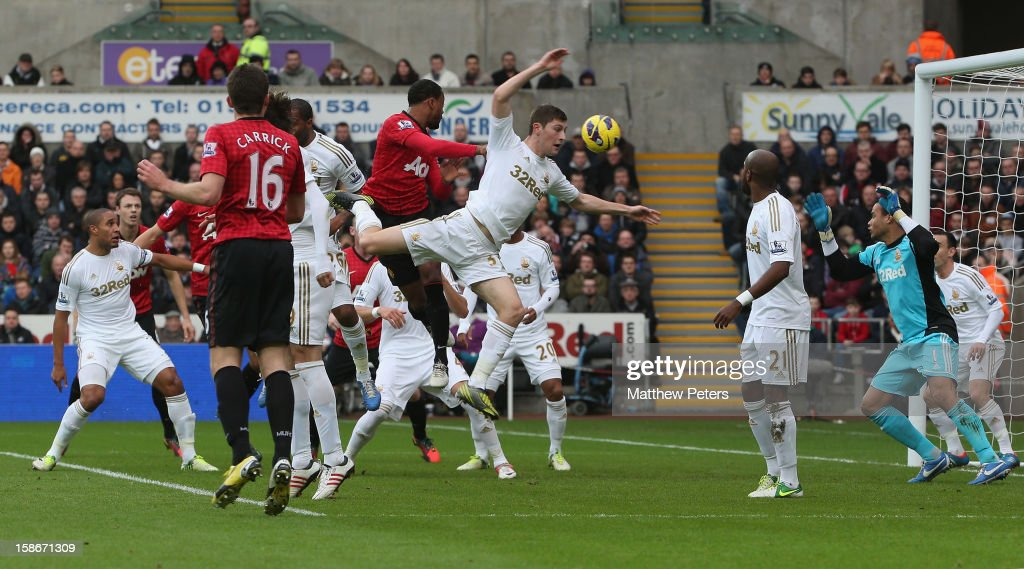 <a gi-track='captionPersonalityLinkClicked' href=/galleries/search?phrase=Patrice+Evra&family=editorial&specificpeople=714865 ng-click='$event.stopPropagation()'>Patrice Evra</a> of Manchester United scores their first goal during the Barclays Premier League match between Swansea City and Manchester United at Liberty Stadium on December 23, 2012 in Swansea, Wales.