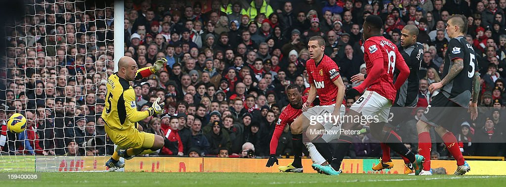 <a gi-track='captionPersonalityLinkClicked' href=/galleries/search?phrase=Patrice+Evra&family=editorial&specificpeople=714865 ng-click='$event.stopPropagation()'>Patrice Evra</a> of Manchester United scores their second goal during the Barclays Premier League match between Manchester United and Liverpool at Old Trafford on January 13, 2013 in Manchester, England.