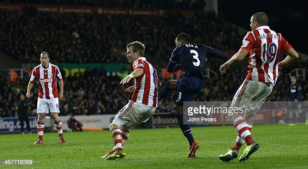 Patrice Evra of Manchester United scores their second goal during the Capital One Cup Fifth Round match between Stoke City and Manchester United at...
