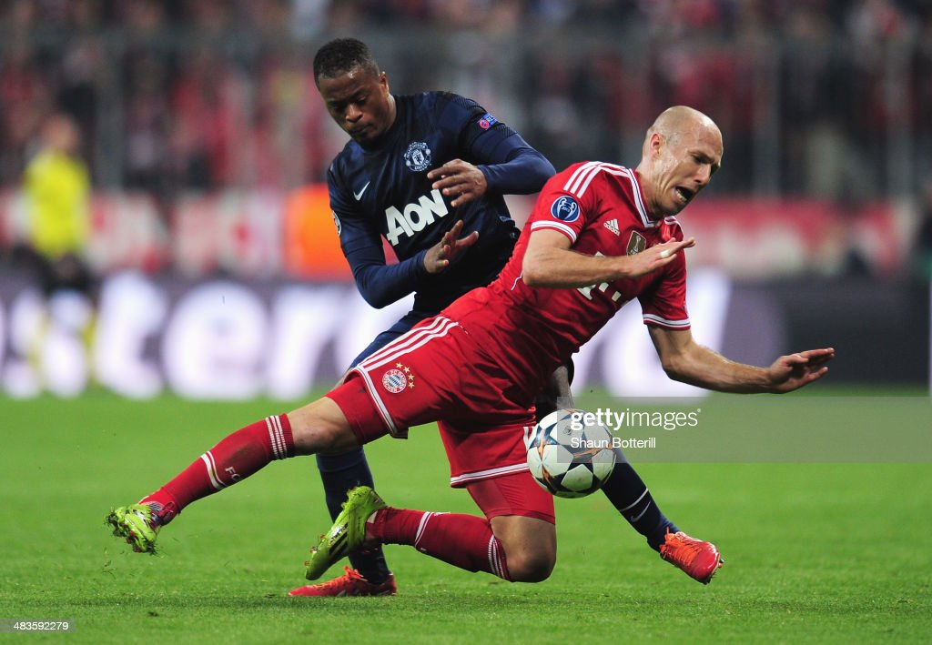 <a gi-track='captionPersonalityLinkClicked' href=/galleries/search?phrase=Patrice+Evra&family=editorial&specificpeople=714865 ng-click='$event.stopPropagation()'>Patrice Evra</a> of Manchester United tackles <a gi-track='captionPersonalityLinkClicked' href=/galleries/search?phrase=Arjen+Robben&family=editorial&specificpeople=194740 ng-click='$event.stopPropagation()'>Arjen Robben</a> of Bayern Muenchen during the UEFA Champions League Quarter Final second leg match between FC Bayern Muenchen and Manchester United at Allianz Arena on April 9, 2014 in Munich, Germany.