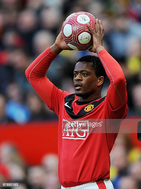 Patrice Evra of Manchester United takes a throw in during the Barclays Premier League match between Manchester United and Fulham at Old Trafford on...