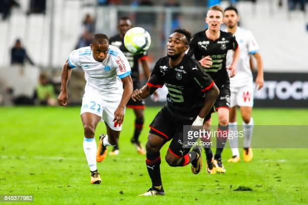 Patrice Evra of Marseille and Faitout Maouassa of Rennes during the Ligue 1 match between Olympique Marseille and Stade Rennais at Stade Velodrome on...