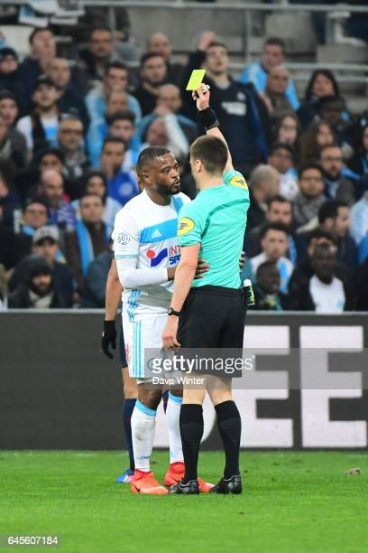 Patrice Evra of Marseille receives a yellow card from referee Benoit Bastien during the French Ligue 1 match Marseille and Paris Saint Germain at...