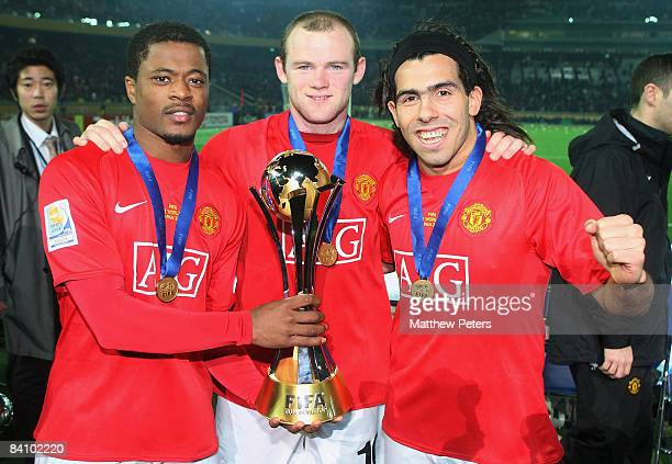 Patrice Evra Wayne Rooney and Carlos Tevez of Manchester United poses with the FIFA World Club Cup after the FIFA World Club Cup Final match between...