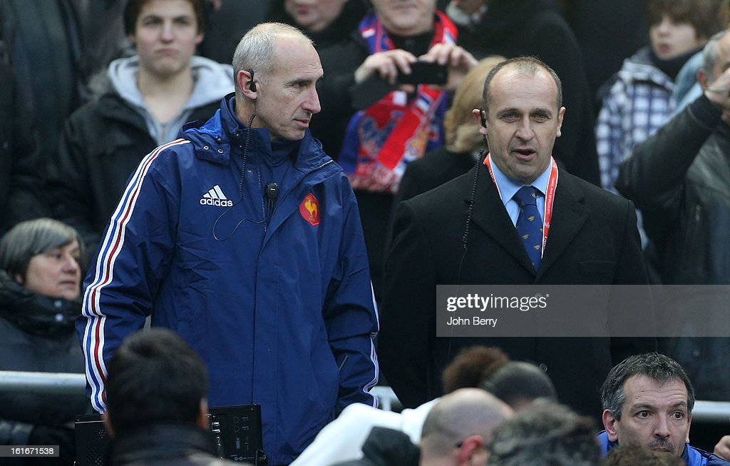 Patrice Lagisquet, assistant-coach and Philippe Saint-Andre, coach of France look on during the 6 Nations match between France and Wales at the Stade de France on February 9, 2013 in Paris, France.