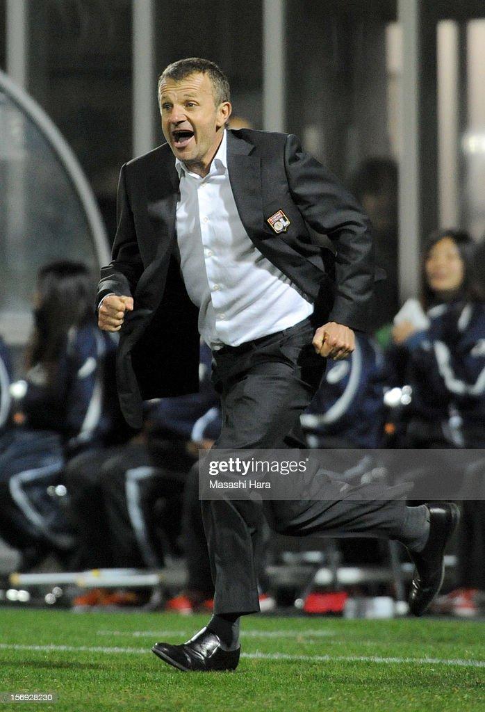 Patrice Lair,coach of Olympique Lyonnais celebrates at time up the International Women's Club Championship Final Match between INAC Kobe Leonessa and Olympique Lyonnais at Nack5 Stadium Omiya on November 25, 2012 in Saitama, Japan.