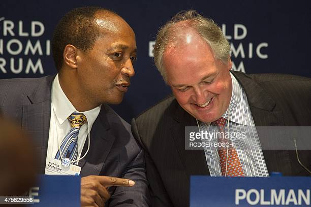 Patrice Motsepe Chairman of African Rainbow Minerals talks to Paul Polman CEO of Unilever during the CoChairs press conference on the second day of...