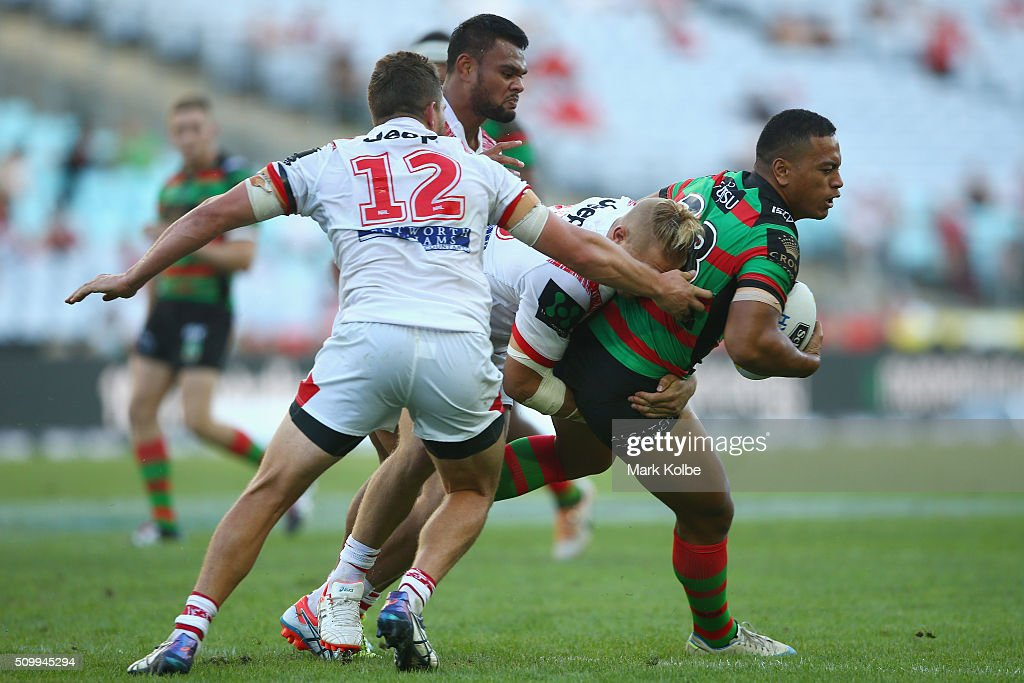 Patrice Siolo of the Rabbitohs is tackled during the NRL Charity Shield match between the St George Illawarra Dragons and the South Sydney Rabbitohs at ANZ Stadium on February 13, 2016 in Sydney, Australia.