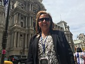 Patricia Acosta a Hillary Clinton delegate from California smiles on July 26 2016 in Philadelphia Pennsylvania as she has admired the Democrat since...