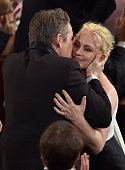 Patricia Arquette is kissed by actor Ethan Hawke after Arquette wins Best Actress in a Supporting Role for 'Boyhood' during the 87th Annual Academy...