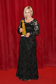 Patricia Arquette poses with her Crystal Nymph Award for her career after the opening ceremony of the 55th Monte Carlo TV Festival on June 13 2015 in...