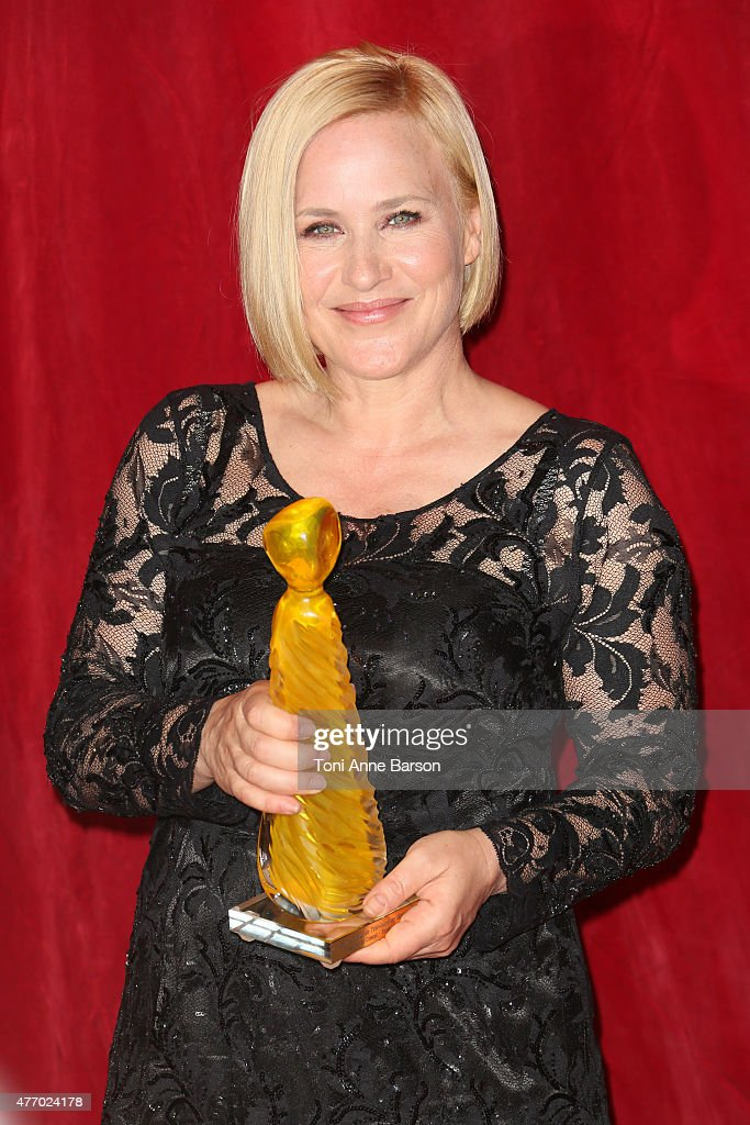 Patricia Arquette poses with her Crystal Nymph Award for her career after the opening ceremony of the 55th Monte Carlo TV Festival on June 13, 2015 in Monte-Carlo, Monaco.