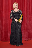 Patricia Arquette poses with her crystal Nymph for her career after the opening ceremony of the 55th Monte Carlo TV Festival on June 13 2015 in...