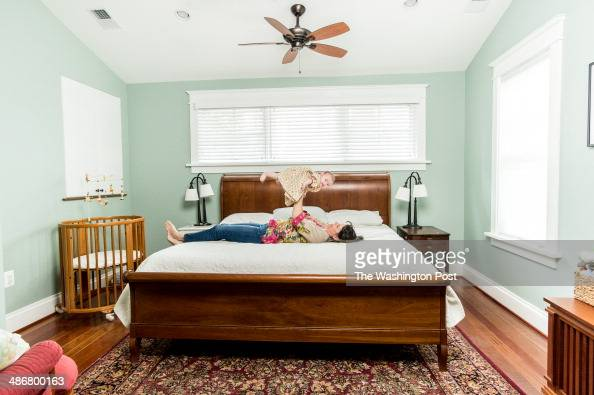 Patricia Balestra relaxing with daughter Ana Huggins in the master bedroom of their recently renovated Craftsman style home in the Chevy Chase...