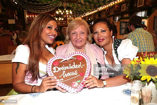 Patricia Blanco her mother Mireille Blanco and her sister Mercedes Blanco pose during the Oktoberfest at AugustinerBraeu at Theresienwiese on...