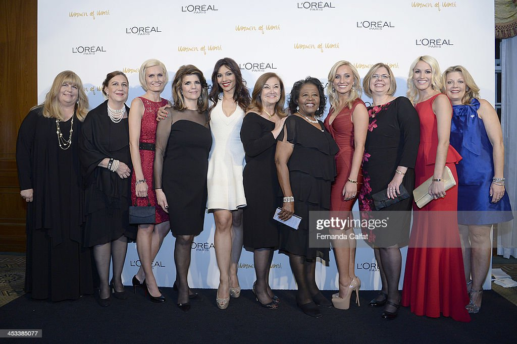 Patricia Boles, Susan Garcia Trieschmann, Kimberly Iverson, Lea Michelle, Somy Ali Maria D'angelo, Estella Pyfrom, Lauren Book, Tricia Baker, Karen Fondu, Kaitlin Roig-DeBells and Lori Lee attend L'Oreal Paris' Women of Worth 2013 at The Pierre Hotel on December 3, 2013 in New York City.
